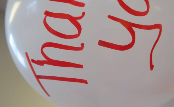 """white balloon with """"Thank You!"""" written in red"""