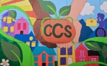 colorful, handcrafted mural featuring CCS and its work in the community